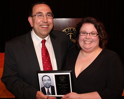 Elia with his wife, Heather, at his induction into the Cortland C-Club Hall of Fame in 2012.