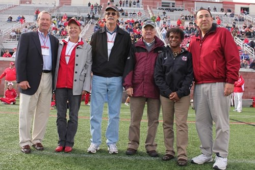 The 2012 Cortland C-Club Hall of Fame inductees honored at a SUNY Cortland football game: from left, Tony Seamans '65, Ann Dunwoody '75, Rick Armstrong '79, John